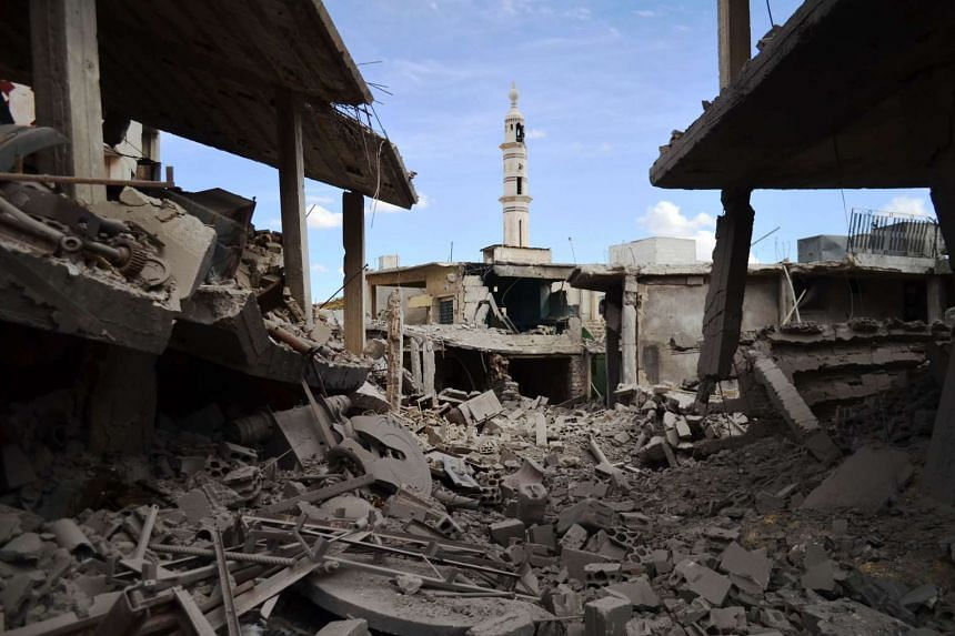 Damaged buildings and a minaret in the central Syrian town of Talbisseh in the Homs province. Russian warplanes carried out air strikes in three Syrian provinces, including Homs, along with regime aircraft on Sept 30, according to a Syrian security s