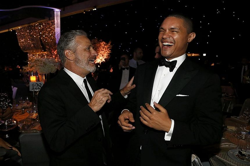 Comic Trevor Noah (left, with Jon Stewart) intends to broaden the horizons of the largely United States-centric The Daily Show that Stewart hosted for 16 years.