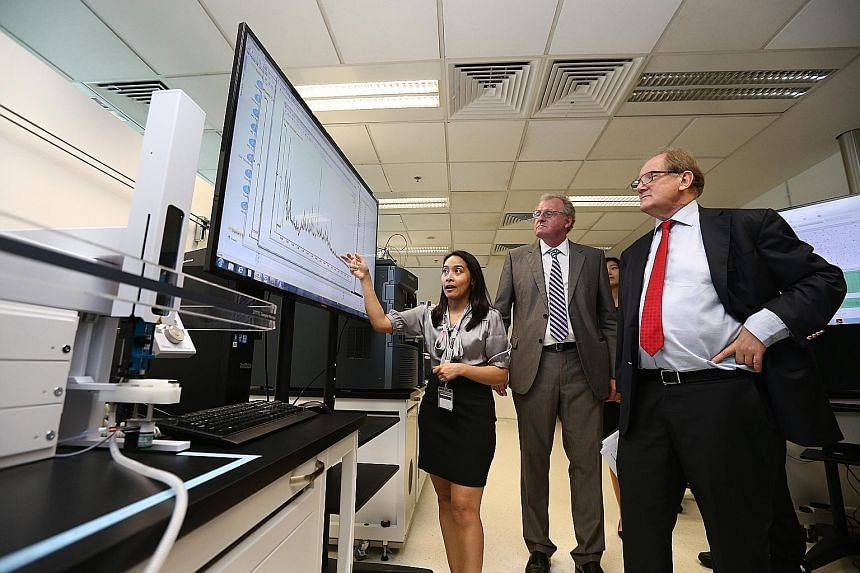 NTU President Bertil Andersson (right) and director of the Singapore Phenome Centre Bernhard Boehm (centre) with one of the centre's researchers at the $9 million research facility, which was launched yesterday.