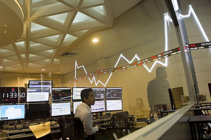 Employees monitoring share prices at the Jakarta Stock Exchange in Indonesia. Resources firms led by mining giant Glencore headed a deep sell-off in Asian markets yesterday, following painful losses across Europe and New York as fears about China's s