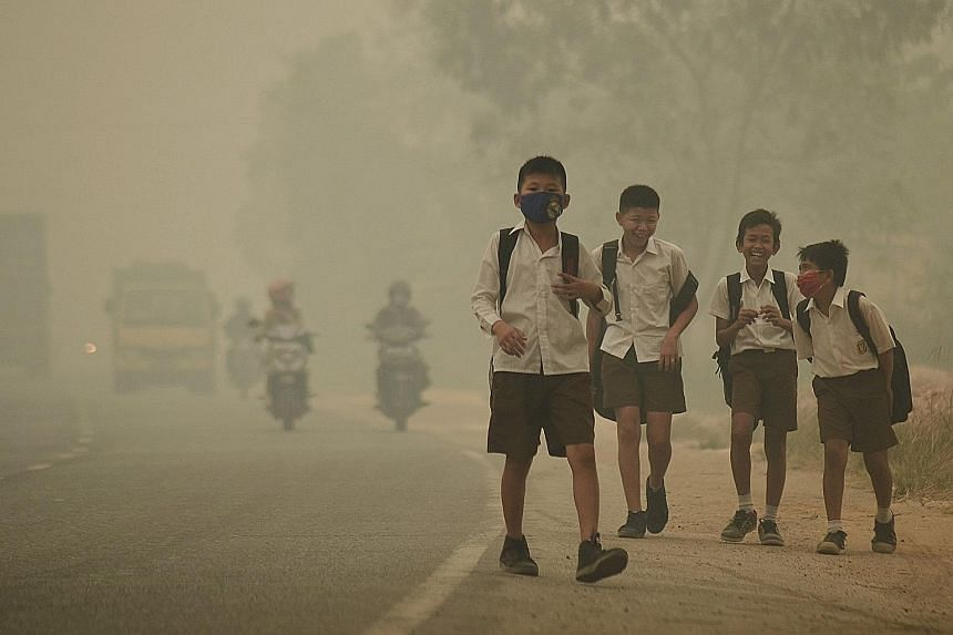 Students in Indonesia's Jambi province were released from school earlier because of the worsening haze yesterday. Indonesia has struggled to put out illegal forest fires in Sumatra and Kalimantan that have blanketed many parts of the country, Singapo