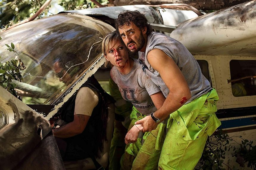 Ignacia Allamand (left) and Ariel Levy are attacked by cannibals in The Green Inferno.