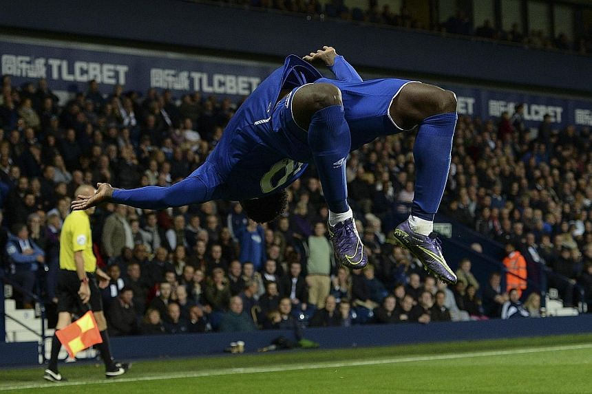 An exuberant Romelu Lukaku doing a somersault after scoring Everton's winning goal as the Toffees came back from 0-2 down to win 3-2 against West Bromwich Albion. Everton move up to fifth in the Premier League table.