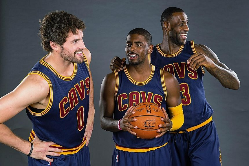 From far left: Kevin Love, Kyrie Irving and James hamming it up during the Cleveland Cavaliers' media day. Love's return from injury will be a boon for James as he will not have to shoulder the bulk of the responsibilities to drive the team forward.