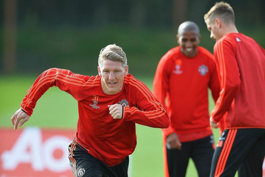 Bastian Schweinsteiger (left) is keen to give advice to Manchester United's young strikers Memphis Depay and Anthony Martial on how to deal with Champions League opponents.