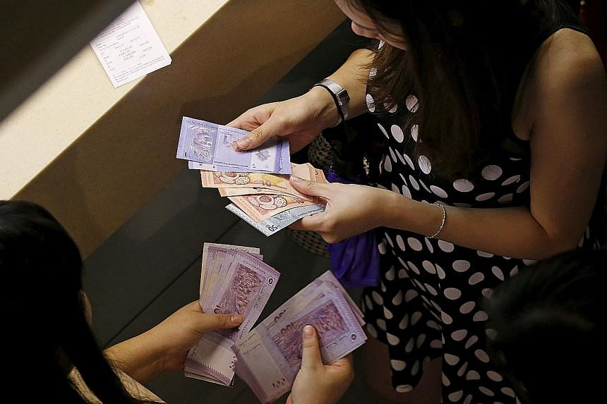 The Malaysian ringgit also lost ground to the Singdollar yesterday, falling 0.73 per cent to 3.1213 against Singapore's currency, a new low since at least 1981.