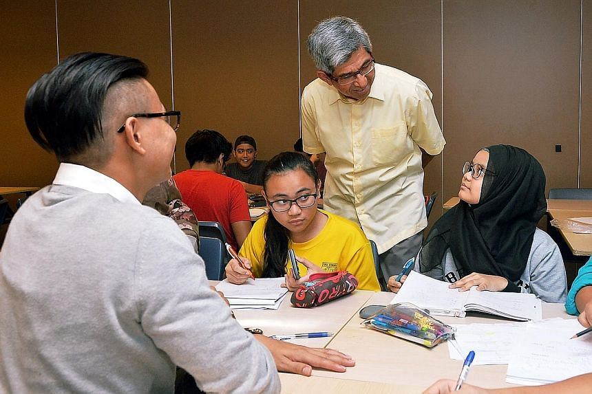 Dr Yaacob Ibrahim, Minister for Communications and Information and Mendaki chairman, with students in the Mendaki Intensive Revision Clinic at Jurong Spring Community Club, in the run-up to the N and O levels.