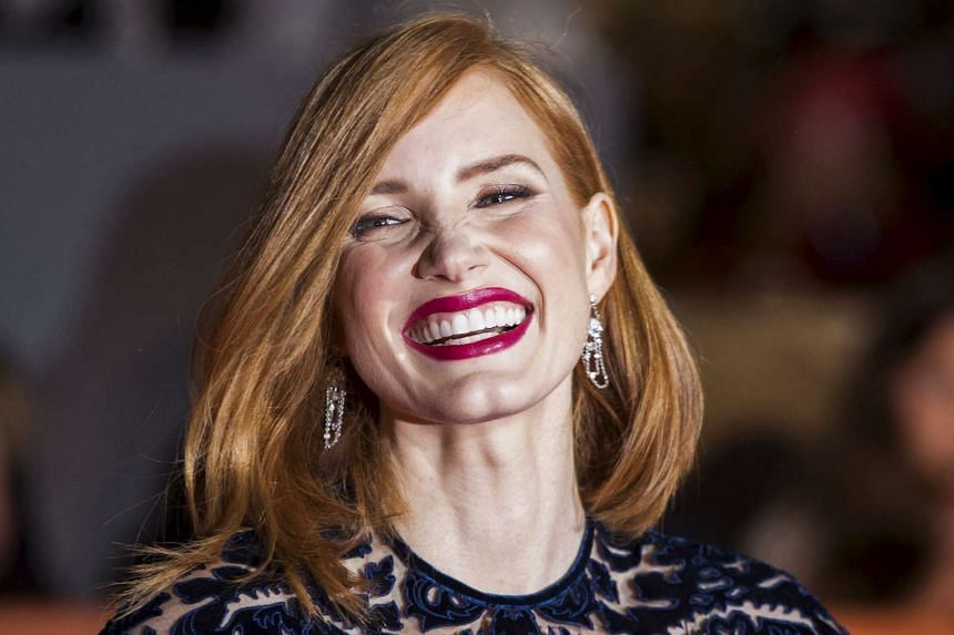 """Jessica Chastain smiles on the red carpet for the film """"The Martian"""" during the 40th Toronto International Film Festival in Toronto, Canada on Sept 11, 2015."""