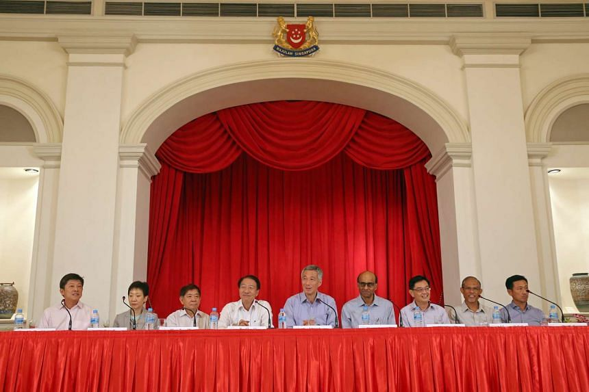 PM Lee Hsien Loong announces his Cabinet and other office holders at a press conference held at the Istana on Sept 28, 2015. He is flanked by (from left) Mr Ng Chee Meng, Ms Grace Fu, Mr Khaw Boon Wan, DPM Teo Chee Hean, DPM Tharman Shanmugaratnam, M