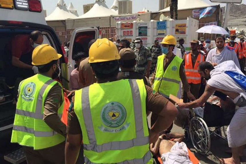 Rescue workers providing first aid to pilgrims after a stampede in Mina, near Mecca, Saudi Arabia, on Sept 24, 2015.