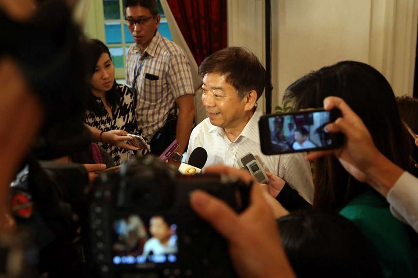 Mr Khaw Boon Wan speaking to the media after a press conference in the Istana on Sept 28, 2015, after he was appointed the new Minister for Transport.