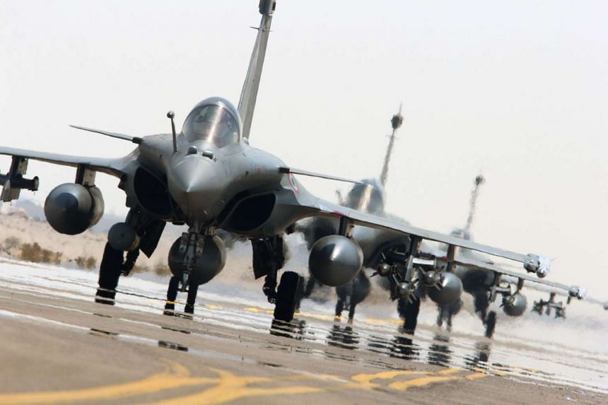 French army Rafales sit on the tarmac of a base in The Gulf as part of France's Operation Chammal, launched in September 2015 in support of the US-led coalition against the Islamic State in Iraq and Syria (ISIS).