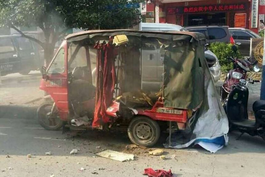 A vehicle is seen damaged after explosions hit Liucheng county, Guangxi Zhuang Autonomous Region, China, Sept 30, 2015.