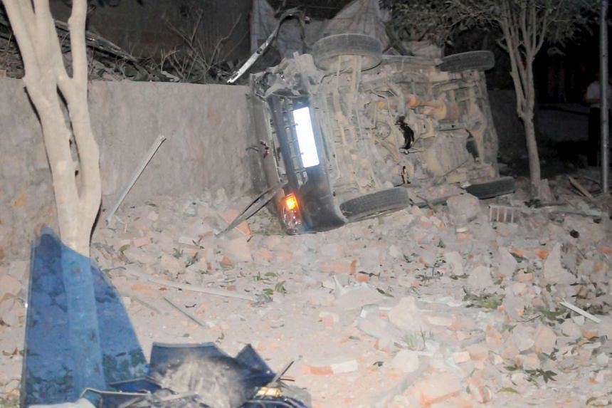 An overturned car is seen after explosions hit Liucheng county, Guangxi Zhuang Autonomous Region, China, Sept 30, 2015.