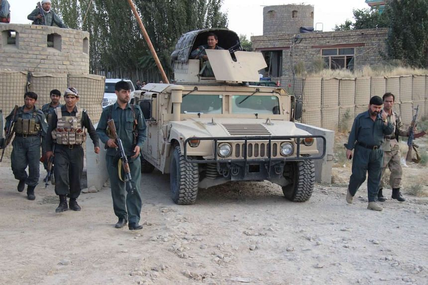 Afghan security personnel keeping watch as heavy fighting erupted near the airport on the outskirts of Kunduz. Heavy fighting erupted near the airport on the city's outskirts as the insurgents closed in late on Sept 29, highlighting the potent challe