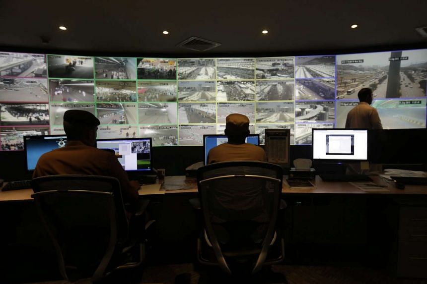 Saudi Interior Ministry staffers work in the control room where footage of some 7,000 cameras is relayed for follow up and intervention during the Haj pilgrimage at the Interior Ministry in Mina, near Mecca, Saudi Arabia.