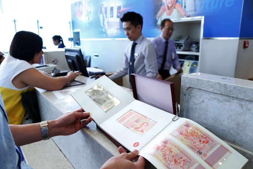Customers queueing for the SG50 Commemorative Notes exchange at a United Overseas Bank branch.