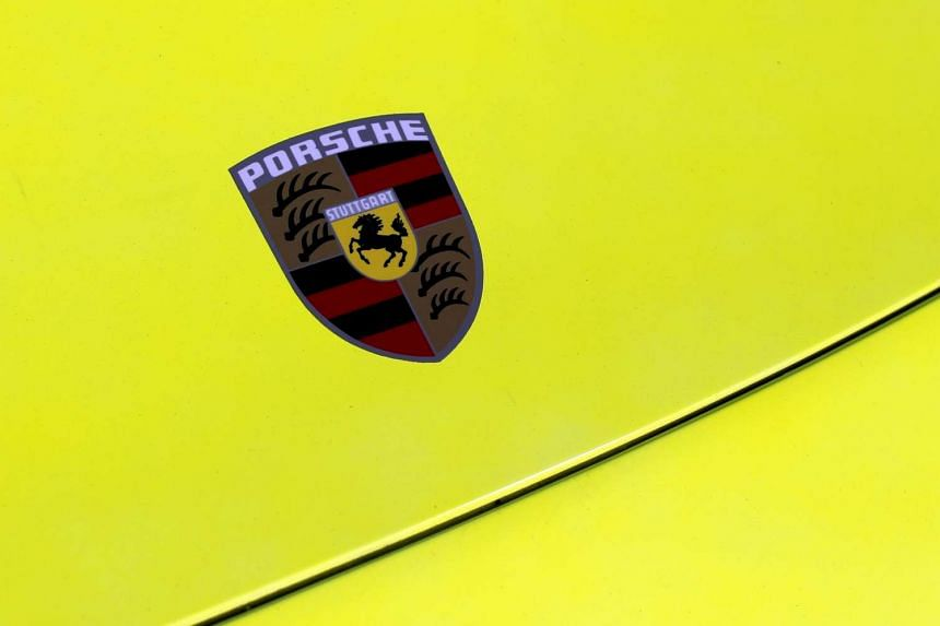 The Porsche logo is seen on the hood of a sports car. Volkswagen's Porsche business said its supervisory board has named Oliver Blume as its new chief executive.