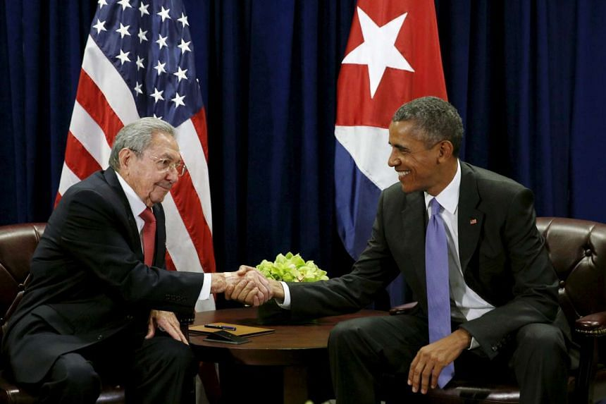 US President Barack Obama (right) and Cuban President Raul Castro shake hands at the start of their meeting at the United Nations General Assembly in New York on Tuesday.
