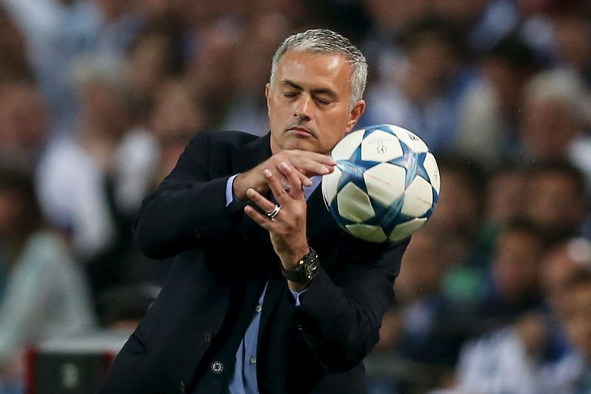 Chelsea manager Jose Mourinho tosses a ball as his Chelsea club goes down to defeat.