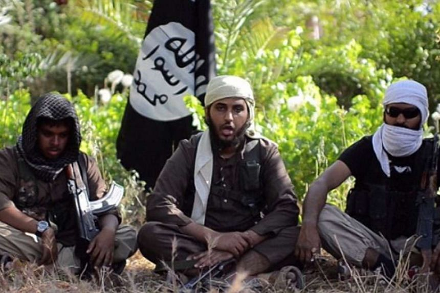 An Islamist fighter, identified as Abu Muthanna al-Yemeni from Britain (centre), in a still image taken from an undated video uploaded to a social media website. He is among five Islamist fighters identified as Australian and British nationals who ha