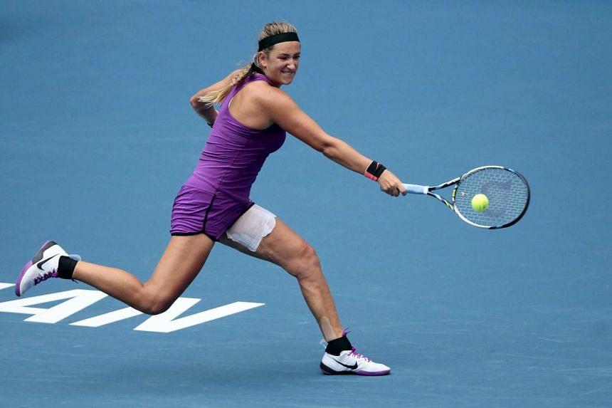 Victoria Azarenka of Belarus returns a shot  during a women's singles match at the Wuhan Open tennis tournament.