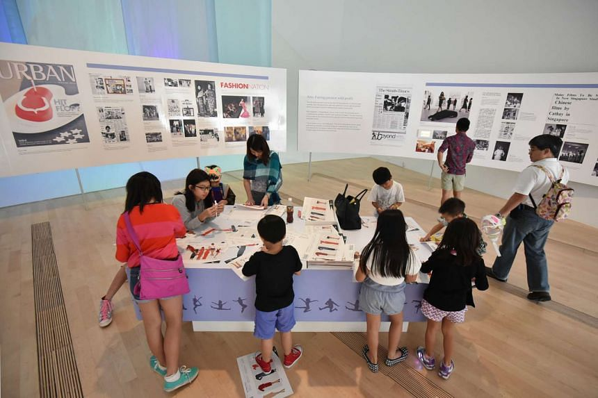 Visitors at The Straits Times' Singapore STories: Then, Now, Tomorrow exhibition held at the ArtScience Museum. The exhibition has received more than 134,000 visitors and ends on Sunday.