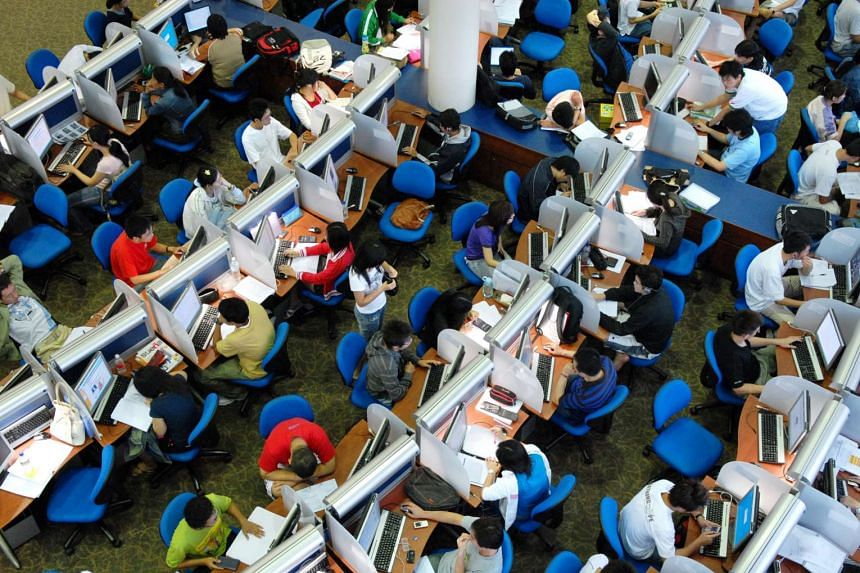 Nanyang Technological University students studying in the Lee Wee Nam library before the examinations.