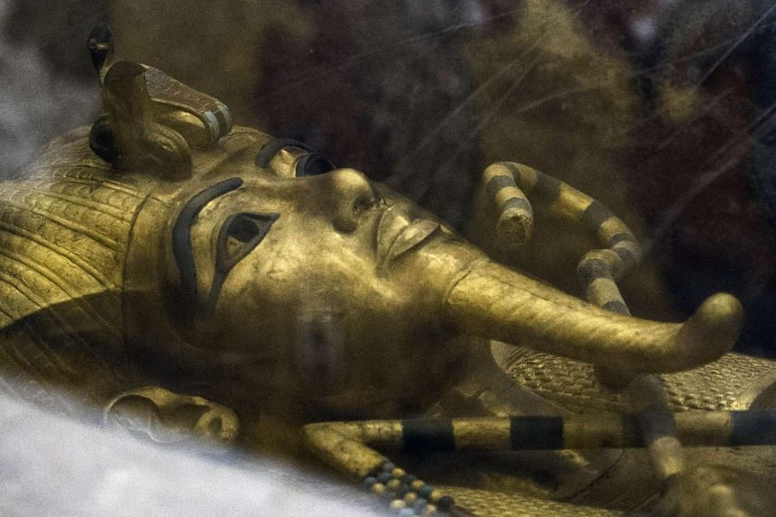 The golden sarcophagus of King Tutankhamun lying in his burial chamber in the Valley of the Kings, south of Cairo.