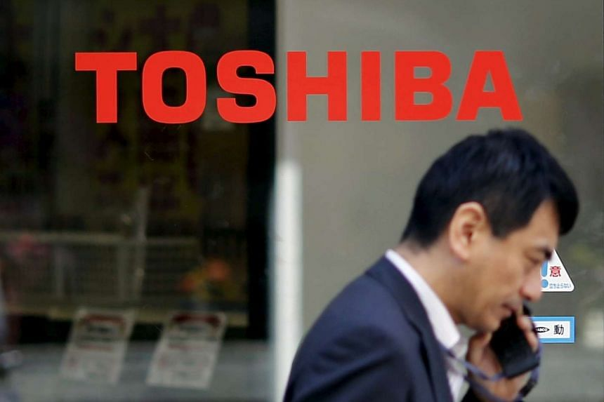Electronics giant Toshiba said it may lay off staff in its under-performing home appliances, TV and PC businesses.