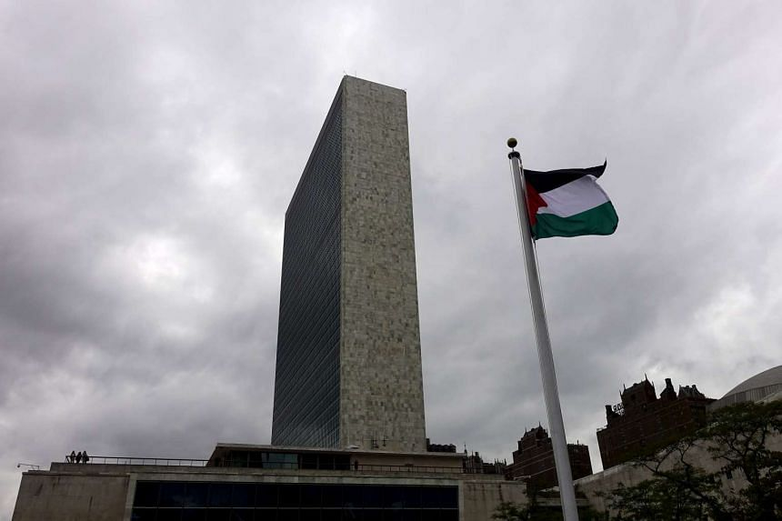 The Palestinian flag flies after being raised by Palestinian President Mahmoud Abbas in a ceremony at the United Nations General Assembly in New York on Sept 30, 2015.