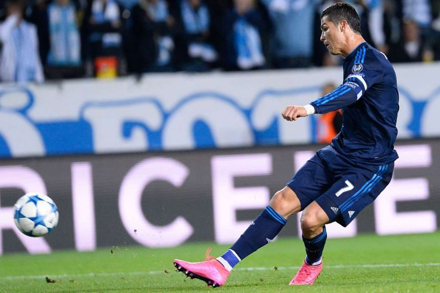 Real Madrid's Portuguese forward Cristiano Ronaldo shoots to score during the UEFA Champions League first-leg Group A football match between Malmo FF and Real Madrid CF at the Swedbank Stadion, in Malmo, Sweden on Sept 30, 2015.