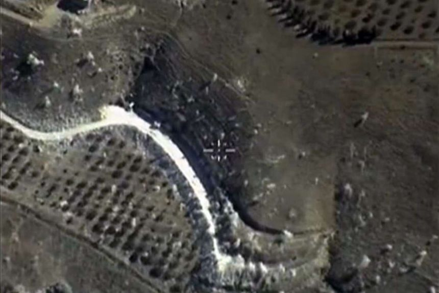 A video grab made on Sept 30, 2015, shows an image taken footage made available on the Russian Defence Ministry's official website, purportedly to show an airstrike in Syria.