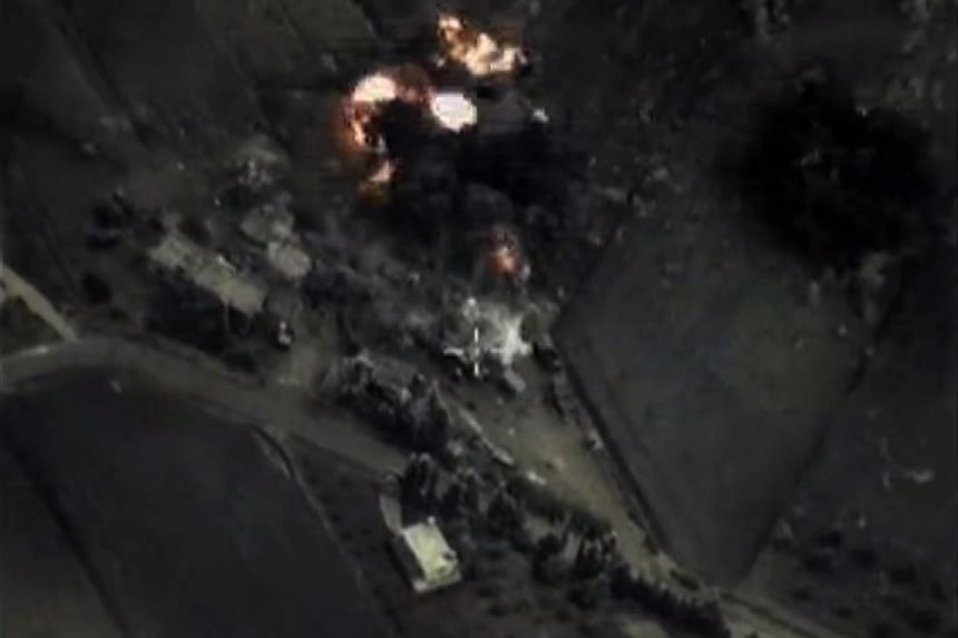 A video grab made on Sept 30, 2015, purportedly shows an airstrike in Syria by Russian warplanes.