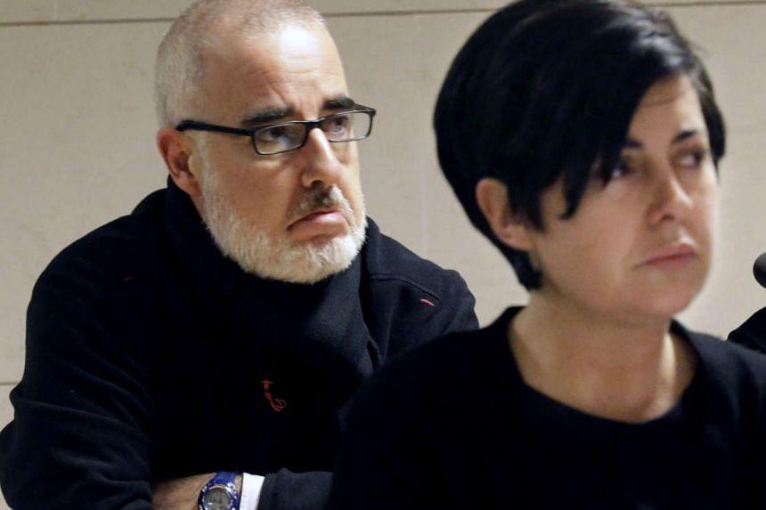 Alfonso Basterra and his ex-wife Rosario Porto, accused of killing of their adopted child Asunta Basterra, 12, on trial at a court in Santiago de Compostela, in the province of Galicia, north-western Spain, on Oct 1, 2015.