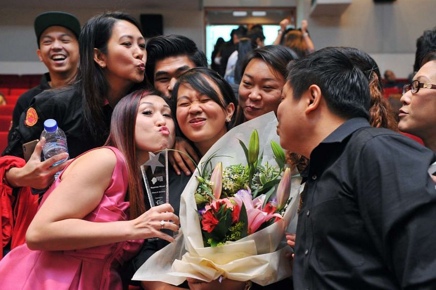 Ms Sampang is congratulated by her colleagues. She won the highest SuperStar Award at the annual Excellent Service Award ceremony.