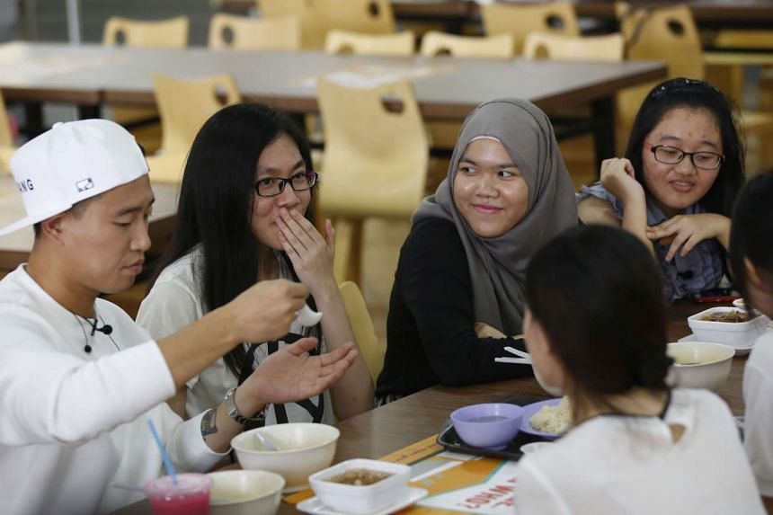 South Korean rapper and Running Man star Gary Kang (left) eating with Singapore Polytechnic students during a surprise filming session for his show School's Out.