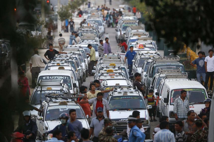 A line of taxis as drivers wait for fuel at a petrol station in Kathmandu, Nepal, on Oct 1, 2015. The Nepalese are facing an acute crisis of petroleum products and other essential commodities after neighboring India stopped supplies.