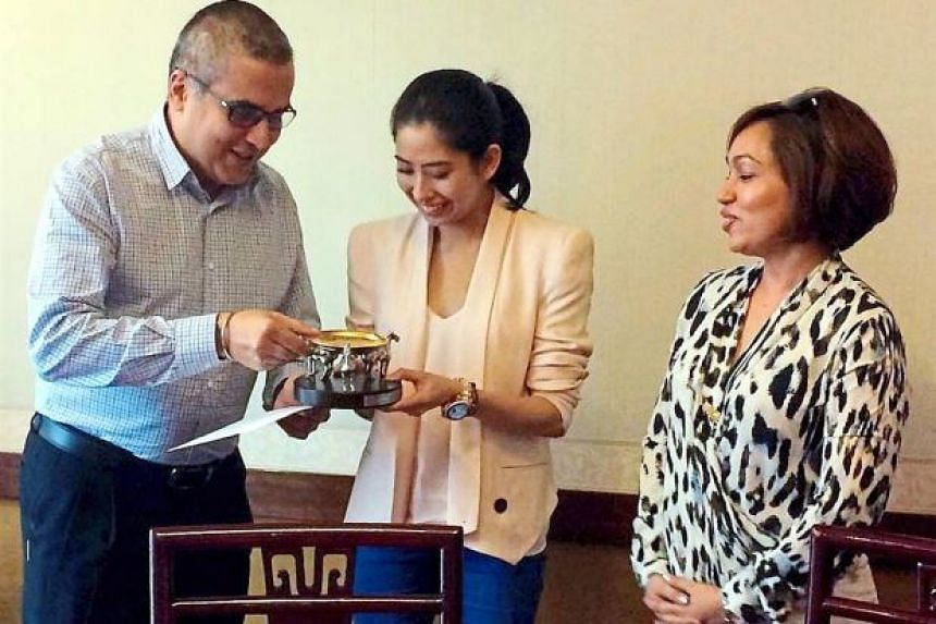 Johor Baru SPCA chairman Ramjeet Singh Bhullar (left) presenting a gift to Tunku Aminah (centre) who was appointed as its royal patron. Tunku Aminah has closed her public Instagram account.