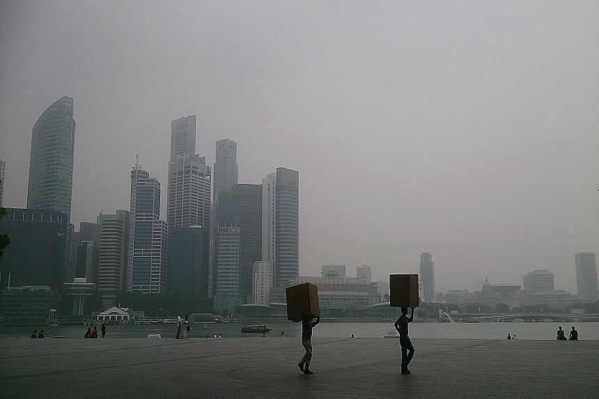 The view of the city skyline from Marina Bay Sands at around 3pm yesterday. The Education Ministry confirmed last night that national exams like the PSLE will proceed as scheduled today. It said schools have made arrangements for candidates to take t