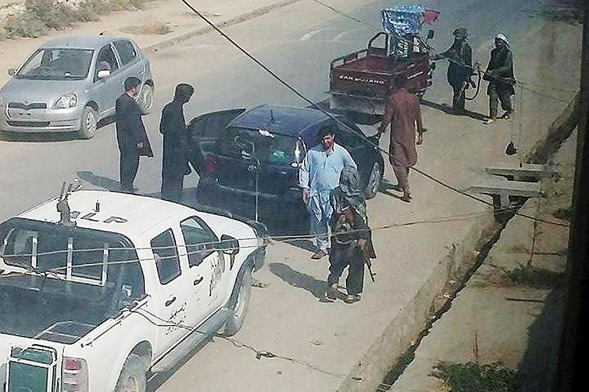 Taleban fighters on a street in Kunduz on Tuesday, a day after they took control of the city. Afghan forces, backed by US air support, are fighting to retake the city.