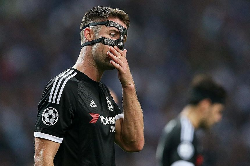 Defender Gary Cahill is a picture of disappointment after Chelsea are beaten by Porto. The London club were unrecognisable from the champions of last season.