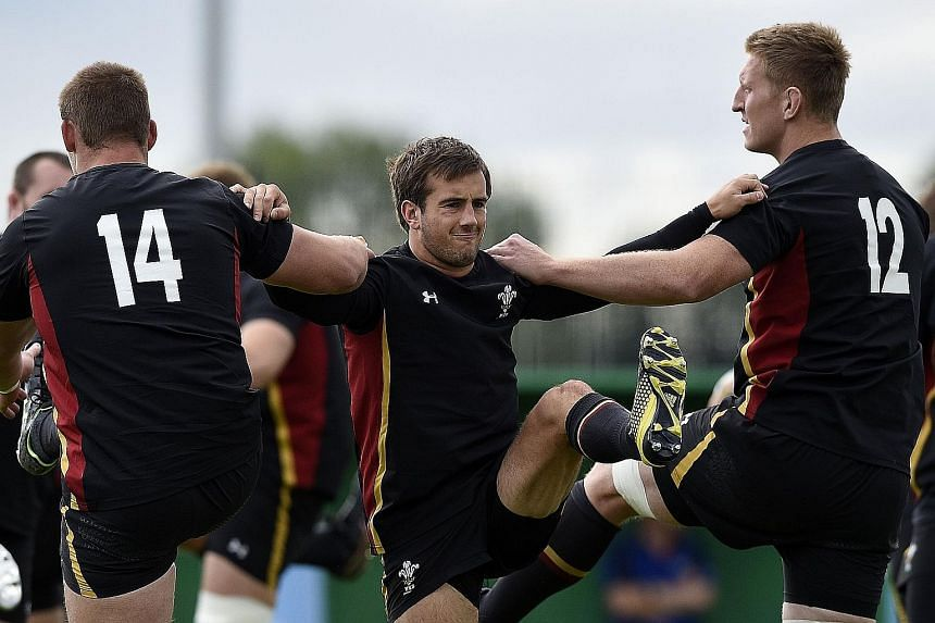 Wales' Matthew Morgan (centre) taking part in a training session. He will play against Fiji, replacing the injured Liam Williams.