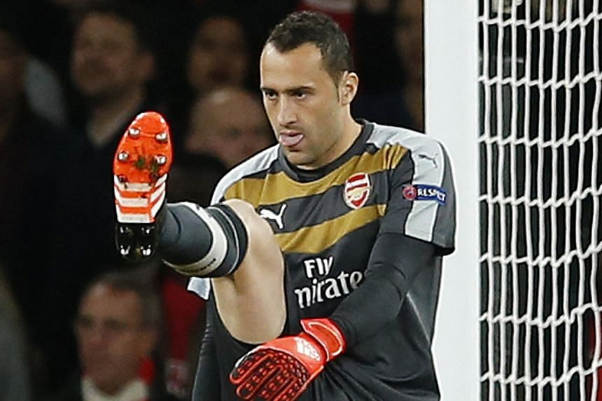 Arsenal goalkeeper David Ospina looking dejected after scoring an own goal to give Olympiakos a 2-1 lead. After two losses, the Gunners have an uphill task to make the round of 16.