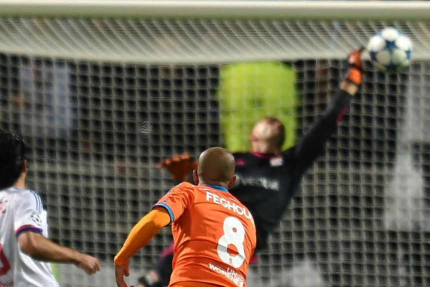 Valencia midfielder Sofiane Feghouli scoring the only goal in the Champions League match against French side Lyon, easing the pressure on coach Santos after a poor start in domestic play.