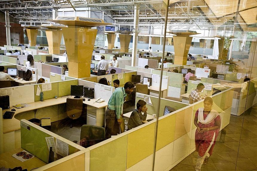 The Mumbai office of Indian outsourcing giant Tata Consultancy Services. In recent years, global outsourcing and consulting firms have obtained thousands of temporary visas to bring foreign workers into the US who have taken over jobs held by America