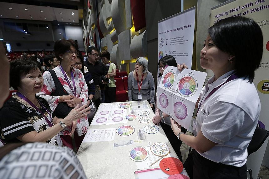 Council for Third Age assistant manager Claire Tan (far right) demonstrating to participants how to use the Positive Ageing Toolkit at the agency's first positive ageing conference yesterday.