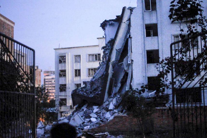 A damaged building is seen after explosions hit Liucheng county, Guangxi Zhuang Autonomous Region, China, Sept 30, 2015.