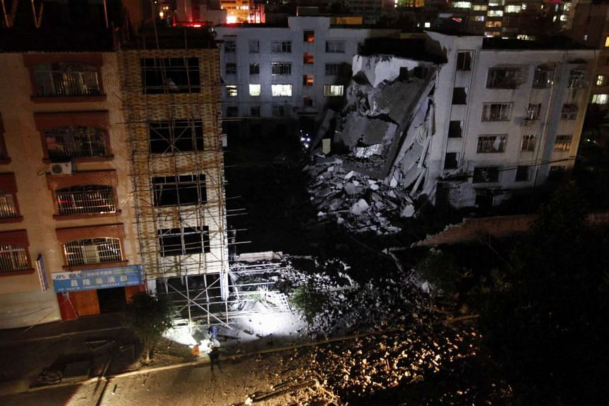 Investigators check the site of a series of blasts at a damaged building in Liucheng county in Liuzhou in south China's Guangxi province on Sept 30, 2015.