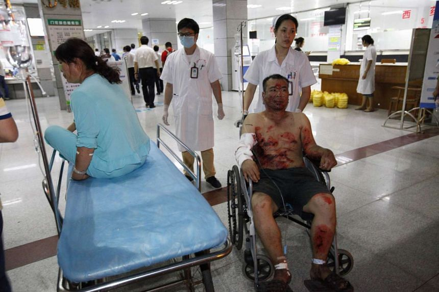Medical staff prepare to transfer people injured in blasts to a hospital in Liuzhou city in People's Hospital in Liucheng, Guangxi Zhuang Autonomous Region, south China, Sept 30 2015.